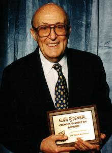 Will Eisner con un Eisner Award